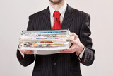 businessman with stack of paper