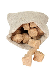 Sack with brown cane sugar cubes isolated on white close-up
