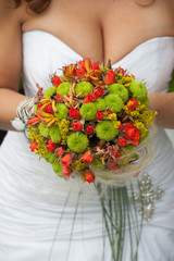 Original wedding bouquet with red and green flowers