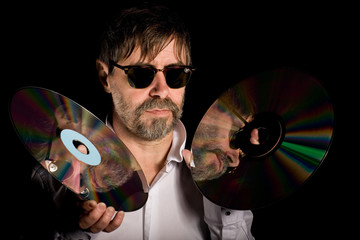 man holds a retro laser discs