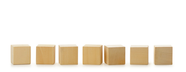 Wooden cubes in row