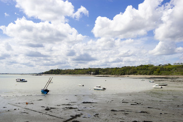 Nicel boats on the calm blue sea at low tide time, northern Fran