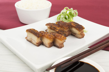 Siu Yuk - Chinese crispy roasted pork belly, rice & dip.