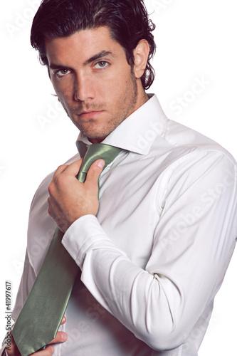 Attractive businessman with green tie