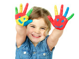 Little girl is proud of her coloured hands