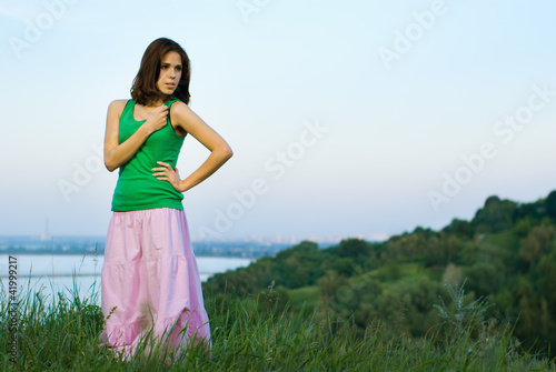 Beautiful girl on green field