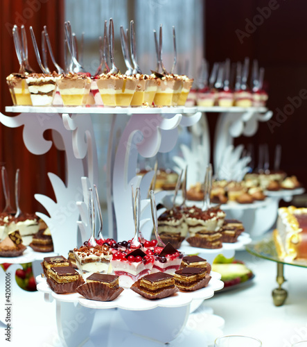 many servings of sweet tasty dessert on buffet