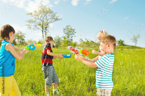 Kids group with water guns and soakers