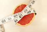Grapefruit with measuring tape
