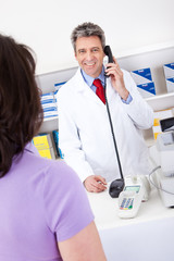 Pharmacist calling on the phone