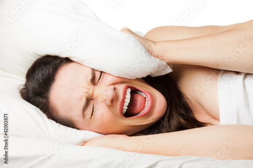 Frustrated woman trying to sleep