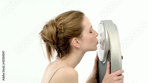 Excited woman with a bathroom scale; Full HD Photo JPEG