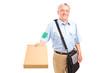 A mature postman delivering parcel