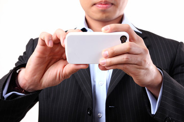Businessman using a mobile camera on the white background