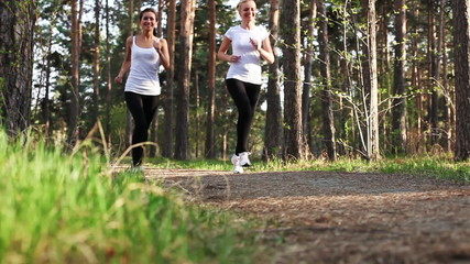 young women runnning in park, evening