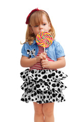 Small girl standing with lollipop
