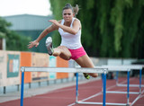 Professional female hurdler during training