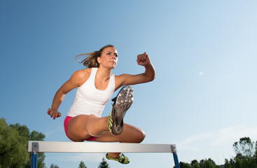 Professional female hurdler in action