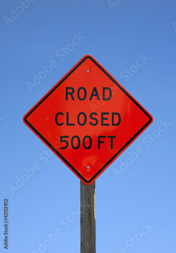Road closed five hundred feet sign
