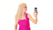 young blonde woman taking photos of yourself by mobile phone