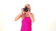 young blonde woman with professional photo camera