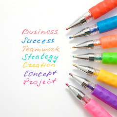 Business words are handwritten with colorful pens.