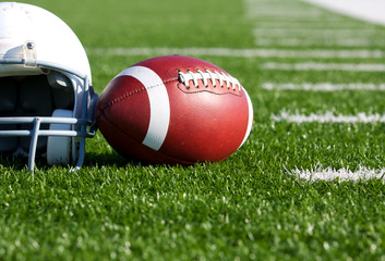 Football and Helmet on the Field
