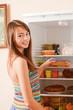 beautiful girl on background refrigerator