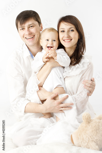 Happy family holding smiling baby over white background
