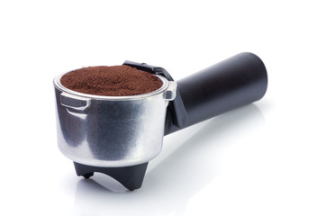 Espresso handle filled with ground coffee
