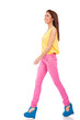 model in pink jeans walking
