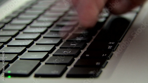 fingers typing on keyboard, motion effect