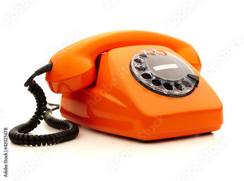 Vintage orange telephone over white background