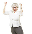 portrait of a cheerful senior woman gesturing victory over white
