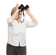 portrait of senior woman looking through a binoculars over white