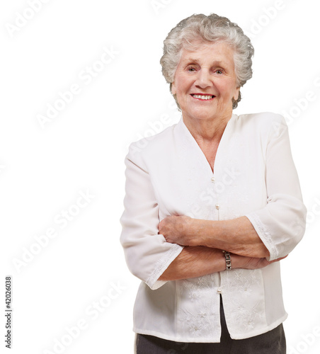 portrait of a adorable senior woman standing over white backgrou