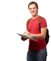 portrait of young student man writing on a notebook over white b