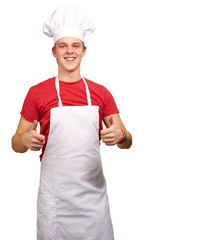 portrait of young cook man doing success symbol against a white