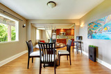 Large bright luxury dining wiith with kitchen in the back.