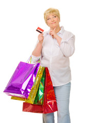Senior woman with bags and credit card