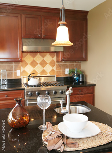 Kitchen granite countertop with plate and glass.