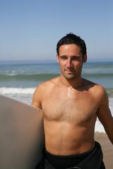 Handsome man surfing