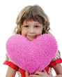 Little girl holding heart