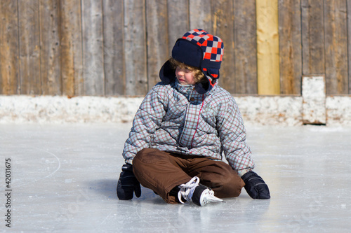 Boy learning to ice skate
