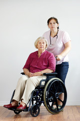 Senior woman and aid or nurse