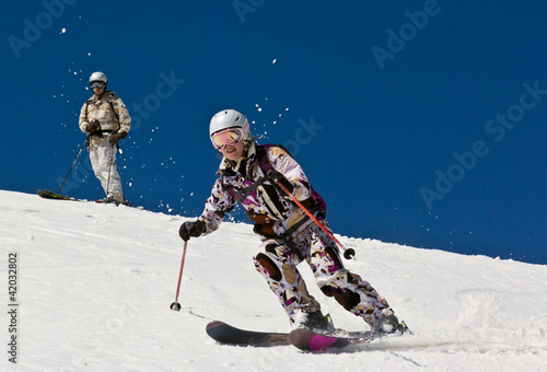 Woman and Man skier in the soft snow.