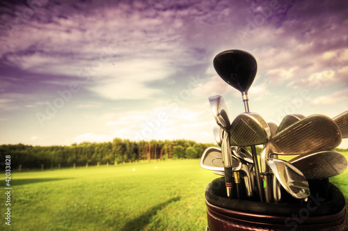 Golf gear, clubs at sunset on golf course - 42033828