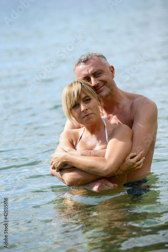 Couple bathing in the sea