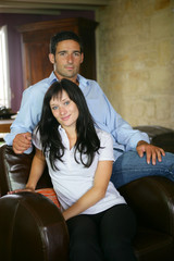 Couple sat in large leather chair