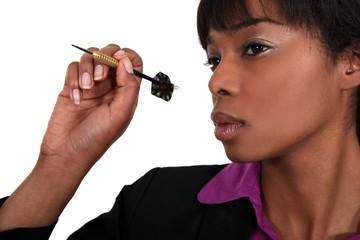 Woman with dart arrow